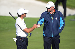 Team Europe's Francesco Molinari and Team Europe captain Thomas Bjorn bump fists during preview day three of the Ryder Cup at Le Golf National, Saint-Quentin-en-Yvelines, Paris. PRESS ASSOCIATION Photo. Picture date: Wednesday September 26, 2018. See PA story GOLF Ryder. Photo credit should read: Adam Davy/PA Wire. RESTRICTIONS: Editorial use only. No commercial use.