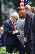 WASHINGTON, DC, USA - 1997/08/05: U.S. Speaker Newt Gingrich signs a copy of the bill for Rep. Steve Chabot, right, following the signing ceremony for the balanced budget bill on the South Lawn of the White House August 5, 1997 in Washington, DC.  (Photo by Richard Ellis)