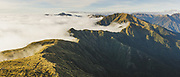 Looking over clouds and Maungahuka ridge, Tararua Forest Park, New Zealand Ⓒ Davis Ulands   davisulands.com