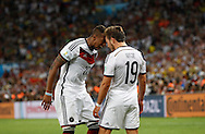 Germany's Mario Götze celebrates scoring their first goal with team mate Jerome Boateng during the 2014 FIFA World Cup Final match at Maracana Stadium, Rio de Janeiro<br /> Picture by Andrew Tobin/Focus Images Ltd +44 7710 761829<br /> 13/07/2014