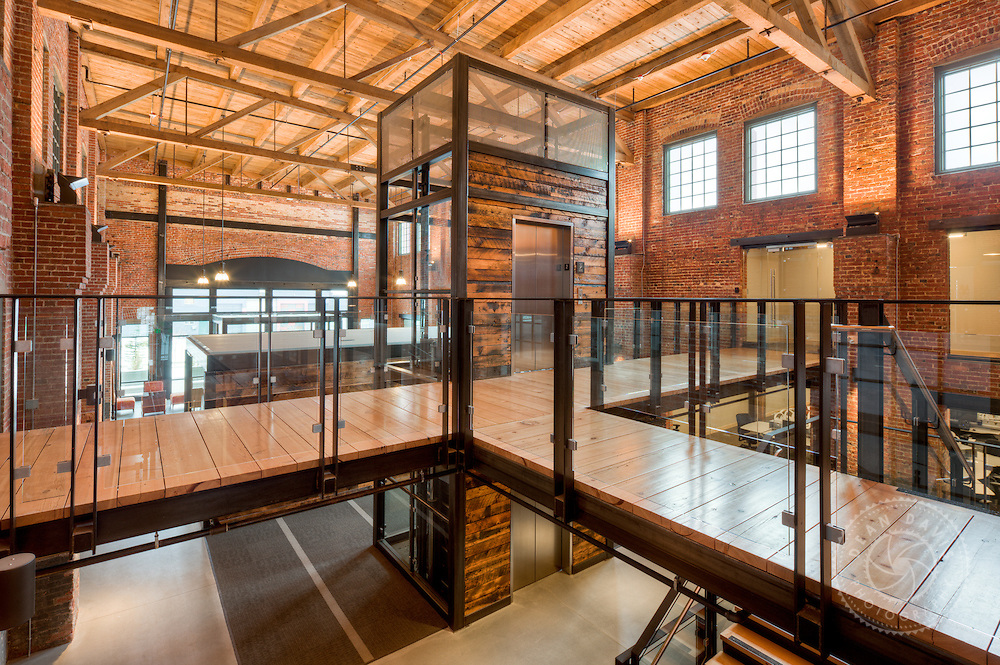 Dean Davis is a commercial photographer based in Spokane Washington and focuses on architecture, heavy industry, advertising, banking, transportation as well as personal fine art work. This is an architectural interior image made for McKinstry at their McKinstry Station location on the Spokane River.