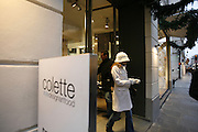 Shopping at the chic, fashionable & stylish 'Colette' shop, rue St.Honoré, in the centre of Paris. The shop has three floors; on the basement is the restaurant; on the ground floor, books, jewellery, cameras and mobile telephones, cd's and dvds, and a bazaar with a bit of everything; on the first floor is ladies and mens clothes.///View of the outside of Colette in Paris