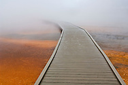 Tourist boardwalk and steam over the fragile ground at the Grand Prismatic Spring, Midway Geyser Basin, Yellowstone National Park, Wyoming