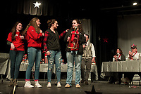 """The Sagacious Spellerzzz Cassie Sousa, Kaitlyn Brooks, Delia Cormier and Allyssa Miner take home the trophy during the LHS Spelling Bee Thursday evening by spelling the word """"perspicacious"""". (Karen Bobotas/for the Laconia Daily Sun)"""