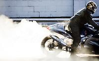A racer readies his motorcycle before drag racing at Acton Raceway in Acton, NJ on June 24, 2008.