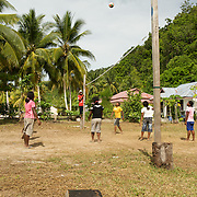 Papuan villagers plaing vollayball.