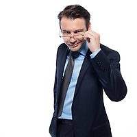man businessman cheerful smiling holding glasses isolated studio on white background