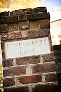 Old marker for Ropermakers Lane on Meeting Street in Charleston, SC.