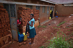 Phiona Mutesi, a 14-year-old chess prodigy, inside Katwe, the largest slum in Kampala, Uganda, Dec. 10, 2010. Mutesi lives in the slums of Uganda and is just now learning to read. But her instincts have made her a player to watch in international chess. Mutesi, a naturally talented chess player is coached by Robert Katende of Sports Outreach Ministry. The chess club meets at the Agape Church.
