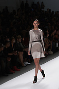 A two-toned dress in silvery-beige by Richard Chai at the Spring 2013 Mercedes Benz Fashion Week show in New York.