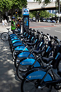 London Cycle Hire bicycles at a docking station. The scheme, sponsored by Barclays is intended to get Londoners cycling. As part of a major initiative. These free (for the first half hour) bikes are then charged for how long you use them. Take a cycle, ride it where you like, then return it, ready for the next person. Available 24 hours a day, all year round. It's self-service and there's no booking. Just turn up and go.