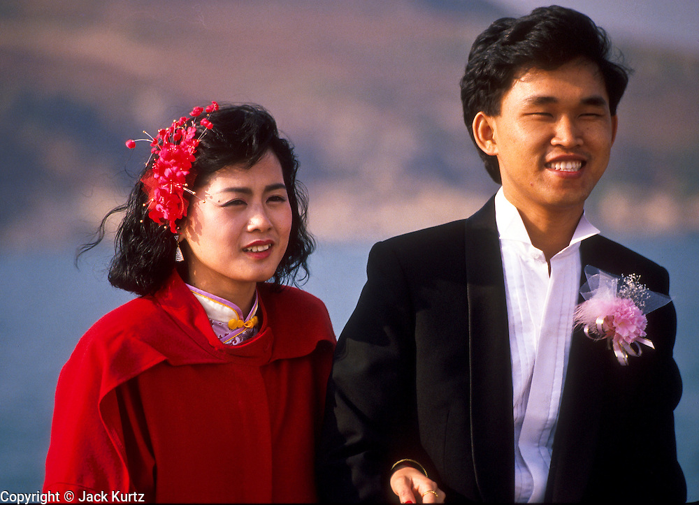 01 DECEMBER 1988   - HONG KONG: A Chinese couple of the Star Ferry on their wedding day Hong Kong.   PHOTO © JACK KURTZ  women  family  lifestyle