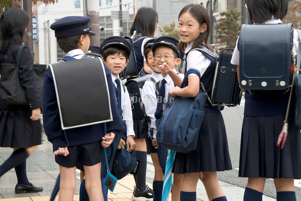 elementary school children looking at the photographer Kyoto Japan