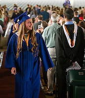 Cassidy Bartlett during Gilford High School's procession to the stage at Meadowbrook Pavilion during commencement on Sunday morning.  (Karen Bobotas/for the Laconia Daily Sun)