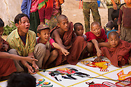 Walking on a trek through the hill villages near Kalaw, we kept hearing about a carnival that was nearby. When we eventually found it, there wasn't much to see, just a few food stands and games to gamble on...These novice monks are betting on a game of huge dice. Betting is a big no-no for monks, but I guess at a once a year carnival, you gotta let the kids be kids.