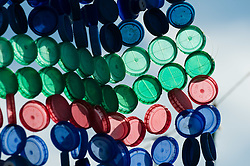© Licensed to London News Pictures. 25/06/2015. Pilton, UK. A sculpture of waste plastic bottle tops in the Green Fields at Glastonbury Festival 2015 on Thursday Day 2 of the festival.  This years headline acts include Kanye West, The Who and Florence and the Machine, the latter having been upgraded in the bill to replace original headline act Foo Fighters.   Photo credit: Richard Isaac/LNP