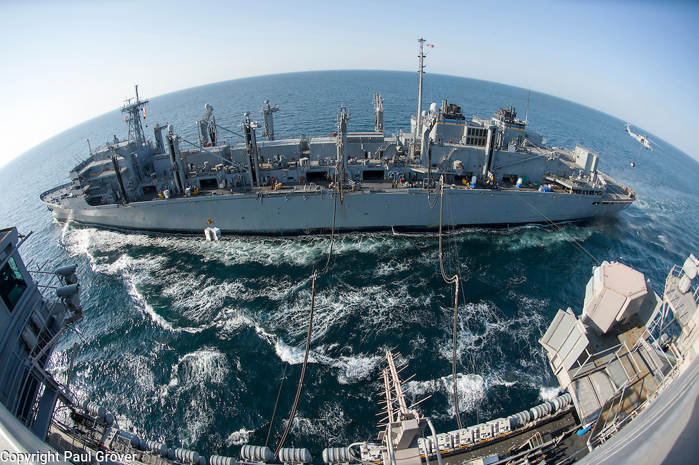 USS John C Stennis CVN-74 Aircraft Carrier.Pic Shows RAS or Replenishment at Sea with oil and supplies