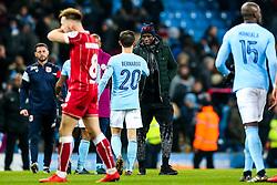Injured Benjamin Mendy of Manchester City congratulates Bernardo Silva after Manchester City win 2-1 in added time - Rogan/JMP - 09/01/2018 - Etihad Stadium - Manchester, England - Manchester City v Bristol City - Carabao Cup Semi Final First Leg.
