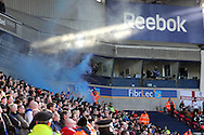 Blackburn fans set a flare off in the Reebok Stadium. Skybet championship match, Bolton Wanderers v Blackburn Rovers at the Reebok Stadium in Bolton, England on Saturday 1st March 2014.<br /> pic by David Richards, Andrew Orchard sports photography.