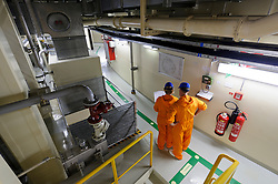 RWE employees work in the nuclear reactor chamber at the RWE nuclear power plant, in Lingen, Germany, on Tuesday, Sept. 6, 2011. (Photo © Jock Fistick)