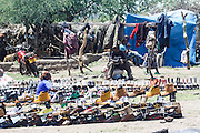 Africa, Tanzania, Frontier Market. The goods are placed on a blanket on the ground