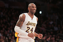 File photo of Los Angeles Lakers' Kobe Bryant is all smiles after an assist from teammate Carlos Boozer during the first half on Sunday, Jan. 4, 2015, at the Staples Center in Los Angeles. (Lawrence K. Ho/Los Angeles Times/TNS/ABACAPRESS.COM)