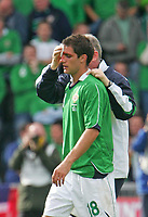 Photo: Andrew Unwin.<br />Northern Ireland v Iceland. European Championships 2008 Qualifying. 02/09/2006.<br />Northern Ireland's Aaron Hughes receives treatment to a cut on his head.