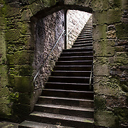 A stone stairway at Caernarfon Castle in northwest Wales. A castle originally stood on the site dating back to the late 11th century, but in the late 13th century King Edward I commissioned a new structure that stands to this day. It has distinctive towers and is one of the best preserved of the series of castles Edward I commissioned.