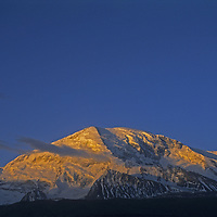 Sunrise dawns on 7,546-meter [Mount] Mustagh Ata in the Pamir Mountains of Xinjiang Province in far western China. .