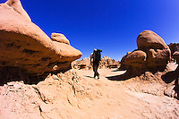 Hiking through the formations of Goblin Valley State Park, Utah