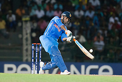 © Licensed to London News Pictures. 28/09/2012. Indian batsmen Irfan Pathan batting during the T20 Cricket World cup match between Australia Vs India at the R.Premadasa Cricket Stadium,Colombo. Photo credit : Asanka Brendon Ratnayake/LNP