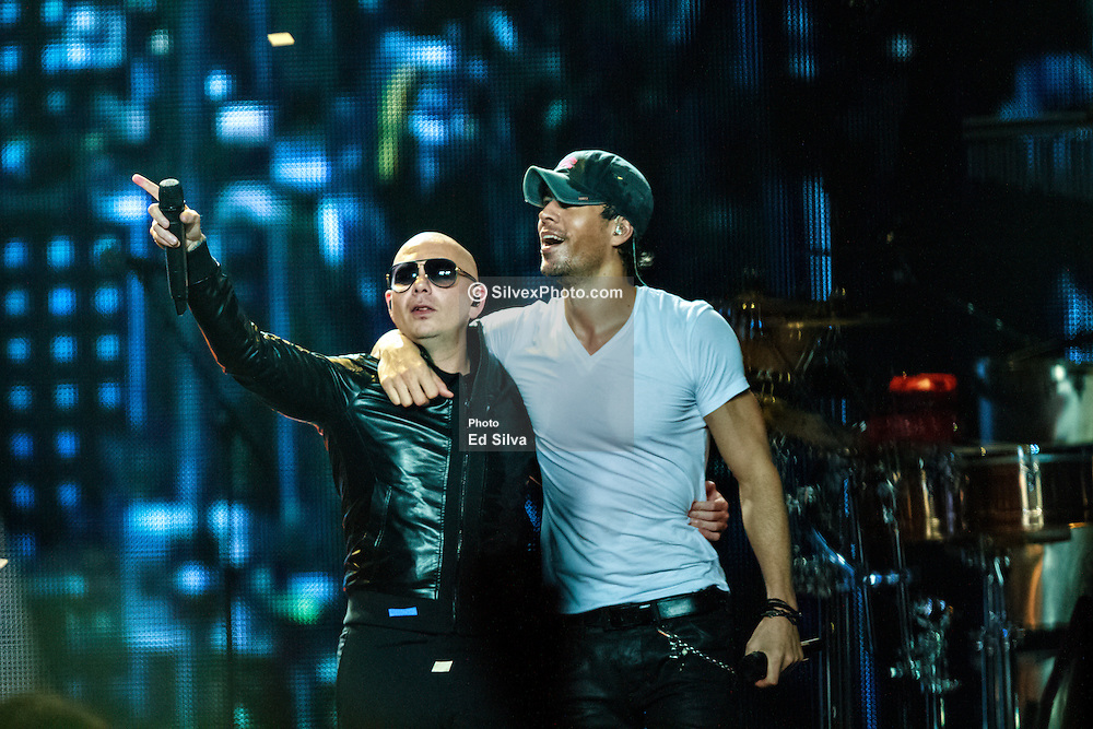 """LOS ANGELES, CA - OCT 11 Latin heartthrob Enrique Iglesias and American rapper Latin Grammy winning artist Pitbull (Armando Christian Pérez) take the stage at their sold-out """"Sex and Love"""" tour at the Staples Center where they had the audience dancing from the floor to the rafters. Los Angeles, USA. 2014 Oct 11. Byline, credit, TV usage, web usage or linkback must read SILVEXPHOTO.COM. Failure to byline correctly will incur double the agreed fee. Tel: +1 714 504 6870."""