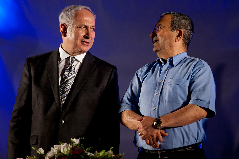 Israel's Prime Minister Benjamin Netanyahu (L) talks with Israel's Defense Minister Ehud Barak, during a graduation ceremony of the National Security College at the Hebrew University in Jerusalem on July 25, 2011.