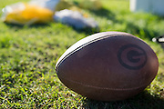 A Grambling State University football sits on the grass before practice in Grambling, Louisiana on October 23, 2013.  (Cooper Neill for The New York Times)