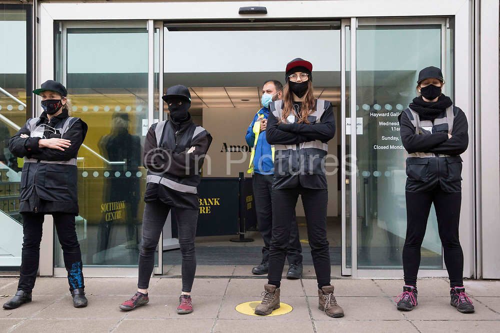 Activists dressed as HS2 enforcement agents take part in a HS2 Chainsaw Massacre protest outside the Among The Trees exhibition at the Hayward Gallery on 30 October 2020 in London, United Kingdom. The protest was intended to highlight both the daily environmental destruction being wrought for the controversial HS2 high-speed rail project and instances of violence and brutality by security guards and bailiffs working on behalf of HS2 Ltd.