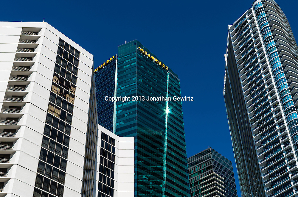 High rise office and residential buildings in downtown Miami along the Miami River. WATERMARKS WILL NOT APPEAR ON PRINTS OR LICENSED IMAGES.
