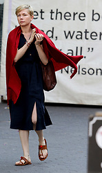 "Michelle Williams wears a red blanket while filming ""After The Wedding"" in Manhattan's Union Square Park. 04 Jun 2018 Pictured: Michelle Williams. Photo credit: LRNYC / MEGA TheMegaAgency.com +1 888 505 6342"