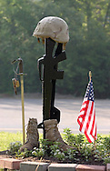 Town of Wallkill, N.Y. - A soldier's boots, weapons and helmet were among the items on display during a Memorial Day service at the Town of Wallkill Memorial Park on May 29, 2006. © Tom Bushey
