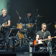 WASHINGTON, DC - October 16th, 2015 - Roger Waters (left) performs with Captain Greg Galeazzi (right) at the Music Heals benefit concert at DAR Constitution Hall in Washington, D.C. The concert benefits Music Corps, an organization that helps injured veterans play music and adjust to postwar life. Galeazzi lost both legs in an IED explosion in 2011 in Afghanistan. (Photo by Kyle Gustafson / For The Washington Post)