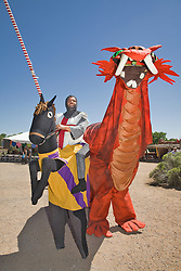 The Renaissance Fair is held each September at the historic museum of El Rancho de Las Golondrinas near Santa Fe and features dancers, kinghts, acrobats and many other performers all celebrating the culture and life style of the Medieval Middle Ages. A member of Cornisa 20 Mariachi Clowns  dons a knights getup to confront a red dragon.
