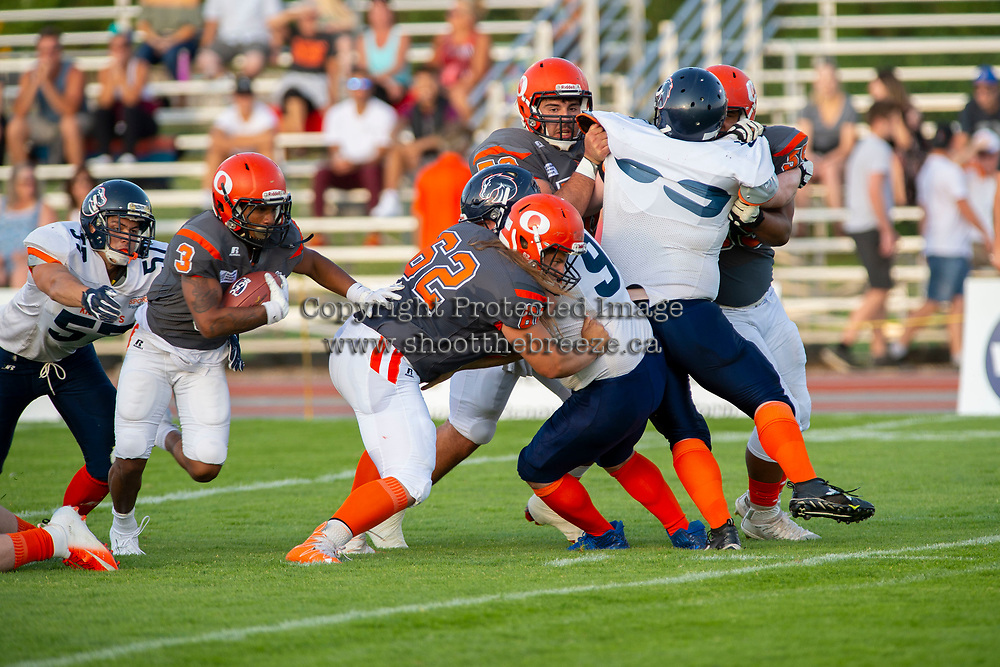 KELOWNA, BC - AUGUST 3:  Malcolm Miller #3 tries to get past JJ Heaton #62 of Okanagan Sun as he tackles Mixon Madland LB #94 of Kamloops Broncos  at the Apple Bowl on August 3, 2019 in Kelowna, Canada. (Photo by Marissa Baecker/Shoot the Breeze)