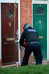 EMBARGO UNTILL 13:00 4th MARCH 2014<br /> South Yorkshire Police Officers force entry with a chain saw to execute a Warrant at an address in Eastwood Rotherham early on Tuesday Morning<br /> <br /> 04 March 2014<br /> Image © Paul David Drabble <br /> <br /> www.pauldaviddrabble.co.uk