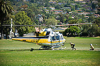LA County fire fighting helicopter lands in field to take on water during Jesusita fire, Santa Barbara, California, May 5, 2009