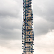 Scaffolding encases the Washington Monument as the landmark undergoes structural repairs caused by an earthquake.