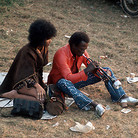 """Miles Davis - rlaxing off stage.- .When asked on stage what the piece of music he was playing was called, Miles replied """"Call it anything"""". The title stuck and to this day it became the unofficial title of that set at the festival. His performance was mostly improvised, and rather like an abstract and pleasing painting that went on for a very long time. This era was known as Miles'Electric Period."""