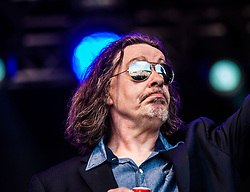 """Jake Black of Alabama 3 play the main stage. Sunday, Rockness 2013, the annual music festival which took place in Scotland at Clune Farm, Dores, on the banks of Loch Ness, near Inverness in the Scottish Highlands. The festival is known as """"the most beautiful festival in the world""""."""