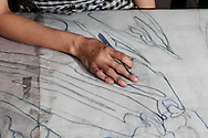 An artist draws outlines before lacquer painting, Ho Chi Minh City, Vietnam Southeast Asia