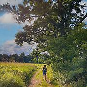 Teenage girl waalks a t rain in Appleton Farms & Grass Rides in Hamilton, MA