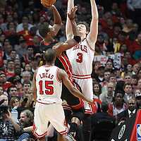 14 March 2012: Chicago Bulls center Omer Asik (3) defends on Miami Heat power forward Chris Bosh (1) during the Chicago Bulls 106-102 victory over the Miami Heat at the United Center, Chicago, Illinois, USA.