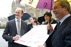 © London News Pictures. 18/05/15. London, UK. Douglas Carswell UKIP MP and Nigel Farage, leader of the UKIP party, sign a petition for electoral reform, Westminster, Central London. Photo credit: Laura Lean/LNP/05/15.